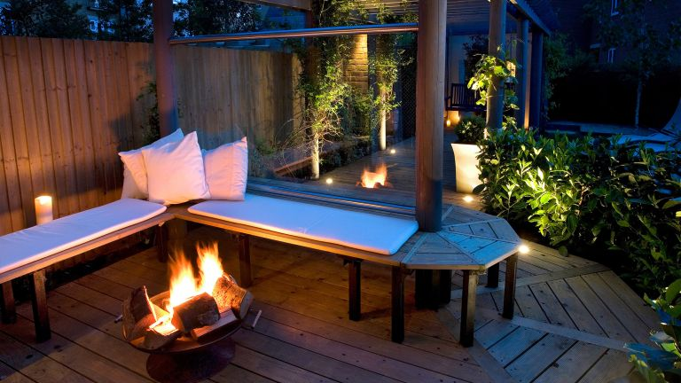 deck lighting ideas with bench and fire pit