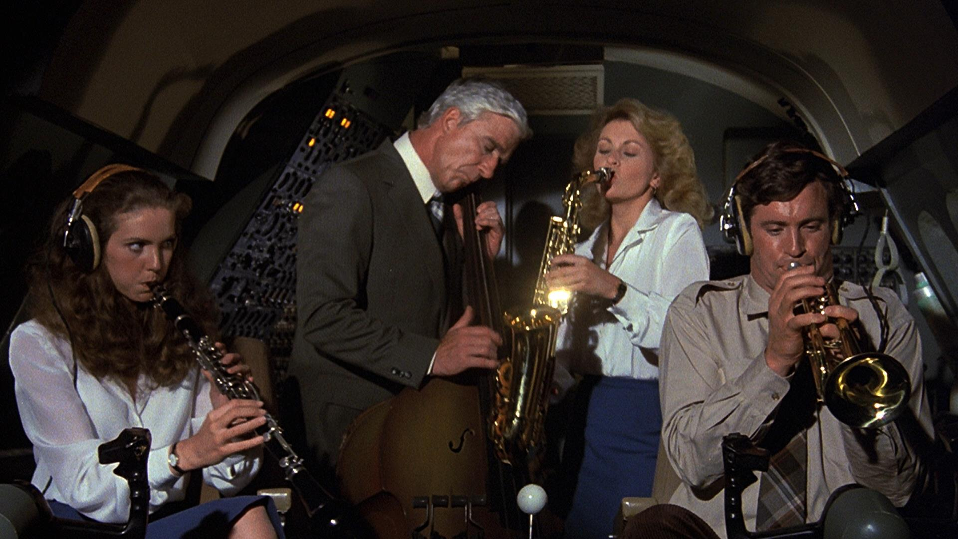 Julie Hagerty, Leslie Nielsen, Lorna Patterson, and Robert Hays playing jazz in the cockpit in Airplane!