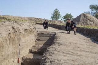 Researchers explore the Viking fortress.