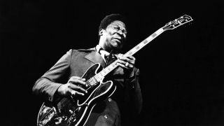 BB King playing guitar onstage in 1971.