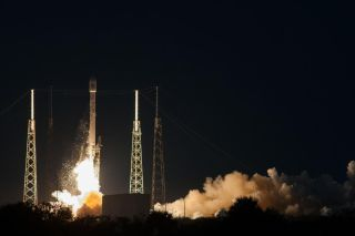 A SpaceX Falcon 9 v1.1 rocket launches the SES-8 commercial communications satellite into orbit from Cape Canaveral Air Force Station in Florida on Dec. 3, 2013.