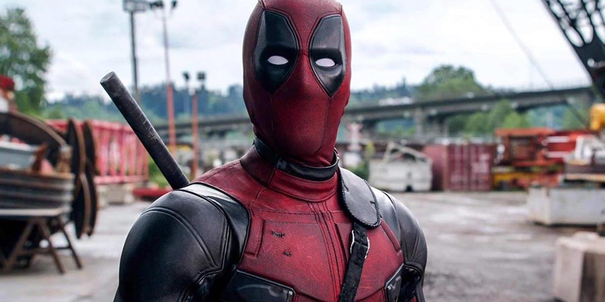Ryan Reynolds as Deadpool in costume looking surprised