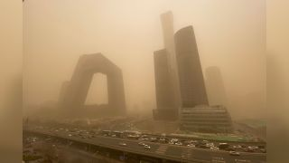 Buildings in the central business district of Beijing start to disappear from view during the sandstorm.