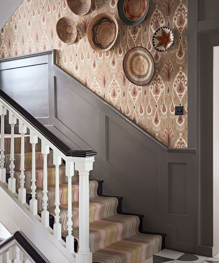 An example of wallpaper trends showing a stairway with beige and red patterned wallpaper