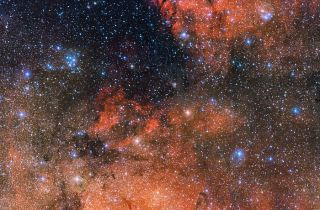 The bright blue stars of the Messier 18 cluster are captured in the upper left of this new image taken by the European Southern Observatory's Very Large Telescope. Messier 18 is known as an open cluster because it contains young, loosely-packed stars.