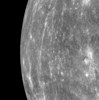 A view of the horizon of Mercury, taken by NASA's Messenger spacecraft on March 29, 2011. The picture shows a stretch of land about 750 miles long, from top to bottom.