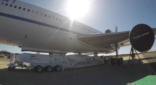 This still from a Vandenberg Space Force Base video shows a Northrop Grumman Pegasus XL rocket carrying the TacRL-2 satellite being loaded onto a Stargazer carrier plane for a June 13, 2021 launch.