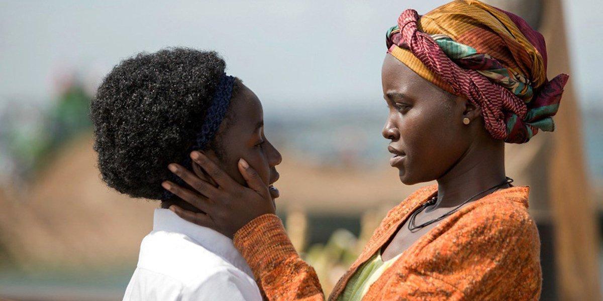 Madina Nalwanga and Lupita Nyong'o looking at each other in Queen of Katwe