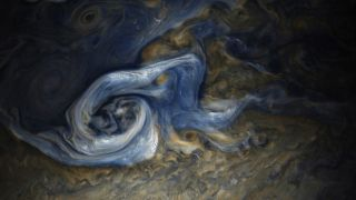 A swirling, colorful storm on the surface of Jupiter.