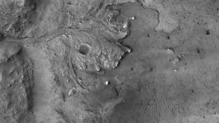The USGS Astrogeology Science Center generated a digital terrain model mosaic and orthomosaic of Mars' Jezero Crater using imagery captured by the High-Resolution Imaging Science Experiment (HiRISE) aboard NASA's Mars Reconnaissance Orbiter. The mosaic, a sample of which is shown here, is the basemap onto which surface hazards were mapped. The hazard map is onboard NASA's Mars rover Perseverance and will be used by the mission's Terrain-Relative Navigation system to help identify the final, hazard-free landing location within Jezero.