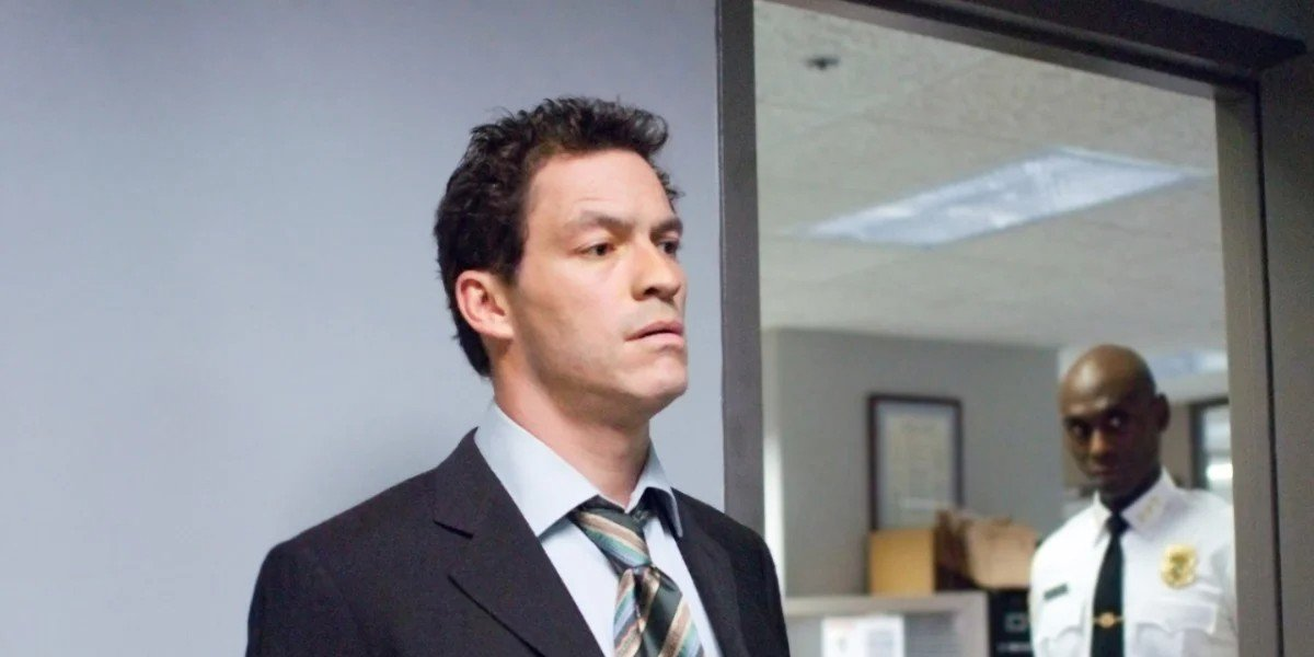 Dominic West in the black jacket and tie