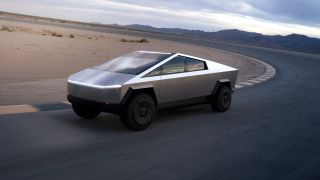 The futuristic Tesla Cybertruck driving on a racetrack in the desert