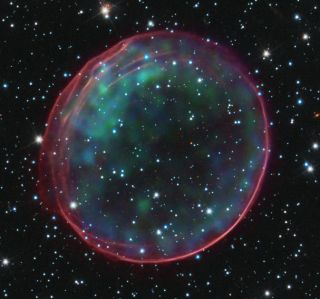 This image of the Type 1a supernova remnant 0509-67.5 was made using data from NASA's Hubble Space Telescope and Chandra X-ray Observatory. Analyses of Type 1a supernovae has led astronomers to conclude that the universe's expansion is accelerating, driven by a mysterious force called dark energy.