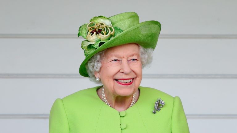 Queen attends the Out-Sourcing Inc. Royal Windsor Cup polo match