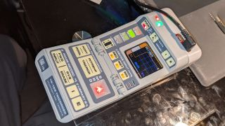 A prototype build of the Tricorder project lays on a desk