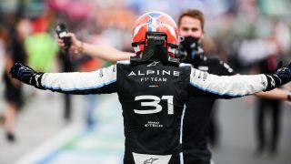 Esteban Ocan (in helmet) celebrates after winning the Formula 1 Hungarian Grand Prix on Sunday, Aug. 1, 2021.