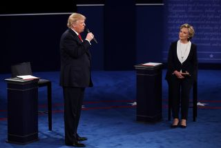 Republican presidential nominee Donald Trump speaks as Democratic presidential nominee Hillary Clinton listens during the town hall-style debate at Washington University om St. Louis, on Oct. 9, 2016.