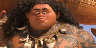 Maui (Dwayne Johnson) looks surprised as he holds his surf board in 'Moana'
