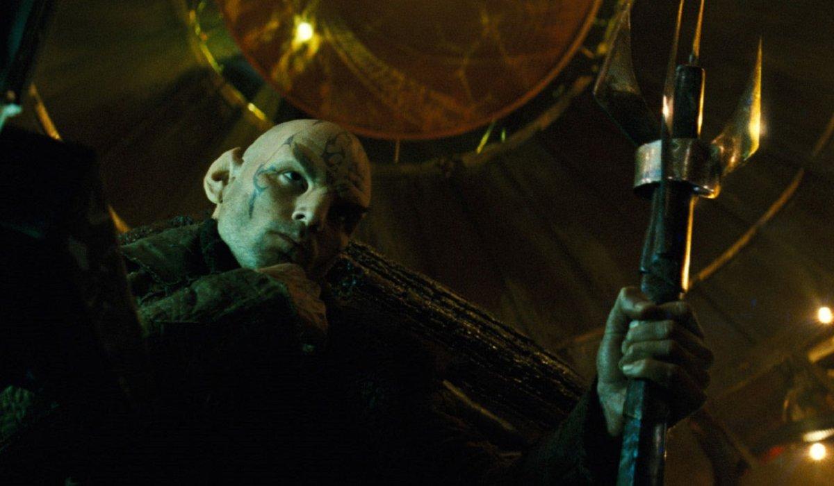 Star Trek Nero sits thinking with a sharp staff in hand