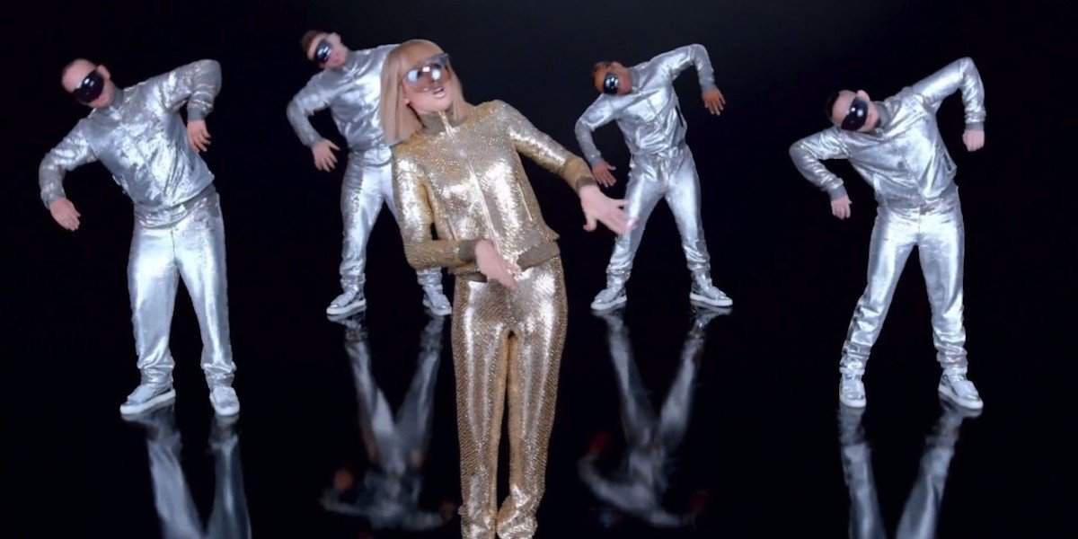 Taylor Swift in gold glitter with backup dancers in Shake it Off music video
