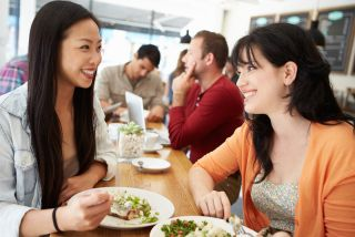 Two women eat lunch at a restuarant