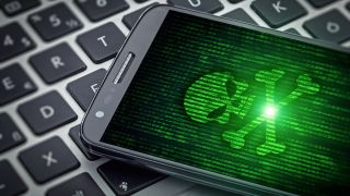 Green skull on smartphone screen.