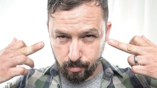 Ben Weinman from Dillinger Escape Plan gives the middle finger