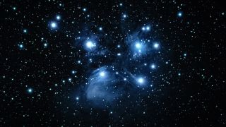 A picture of Messier 45, known as the pleiades star cluster or the Seven Sisters.