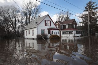 Homes are inundated by floodwater from the Pecatonica River on March 18, 2019, in Freeport, Illinois.