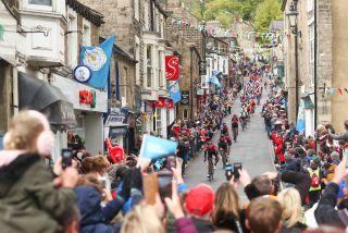 The peloton descends through a Yorkshire town