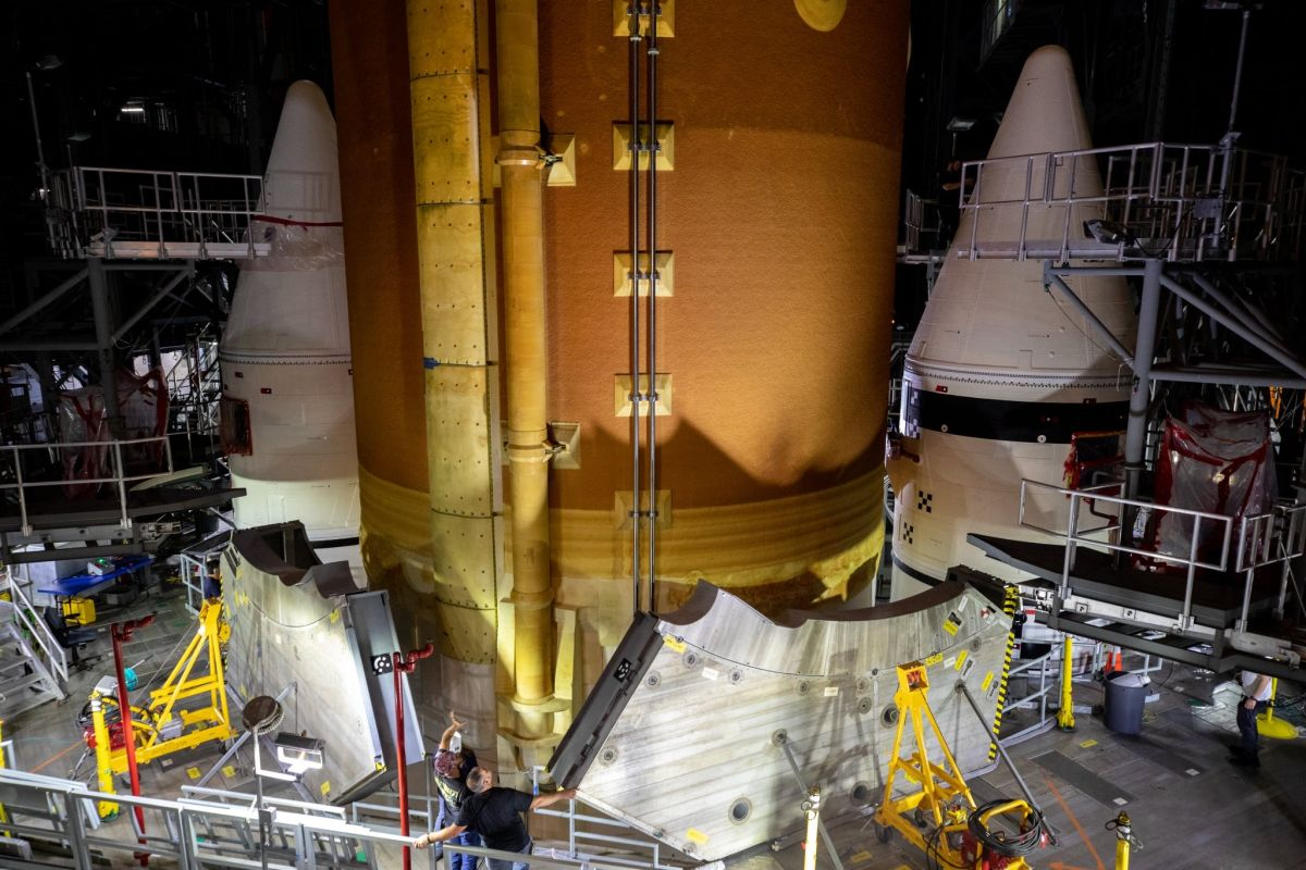 NASA's new moon rocket, the Space Launch System, takes shape in giant hangar