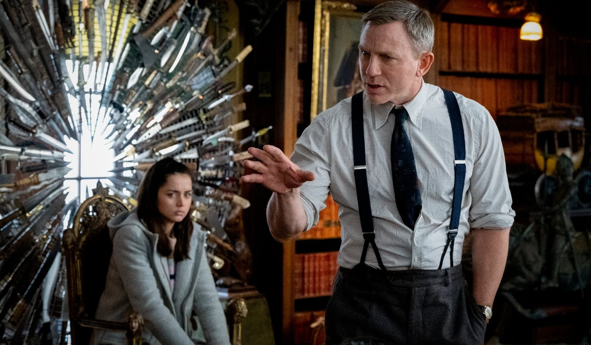 Knives Out Daniel Craig makes his case while Ana De Armas watches on