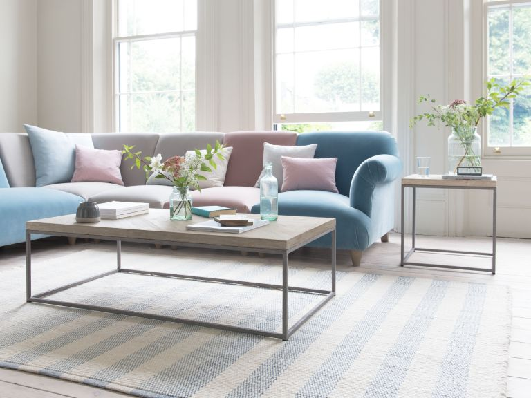 striped rug with coffee table and sofa in living room