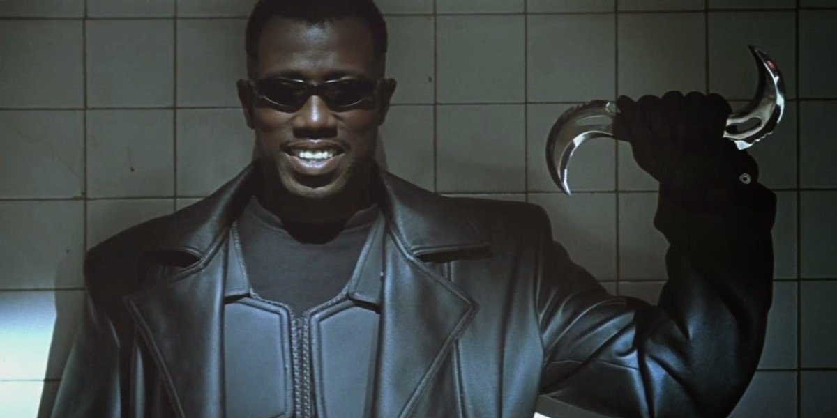 Blade Wesley Snipes smiling with a silver boomerang in his hand