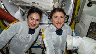 NASA astronauts Jessica Meir (left) and Christina Koch (right) prepare to leave the hatch of the International Space Station and begin the historic first-ever all-female spacewalk, on Oct. 18, 2019.