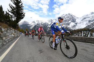 LAGHI DI CANCANO ITALY OCTOBER 22 Hermann Pernsteiner of Austria and Team Bahrain Mclaren Joao Almeida of Portugal and Team Deceuninck QuickStep Pink Leader Jersey Fausto Masnada of Italy and Team Deceuninck QuickStep Passo dello Stelvio Stilfserjoch 2758m Landscape Mountains Snow during the 103rd Giro dItalia 2020 Stage 18 a 207km stage from Pinzolo to Laghi di Cancano Parco Nazionale dello Stelvio 1945m girodiitalia Giro on October 22 2020 in Laghi di Cancano Italy Photo by Tim de WaeleGetty Images