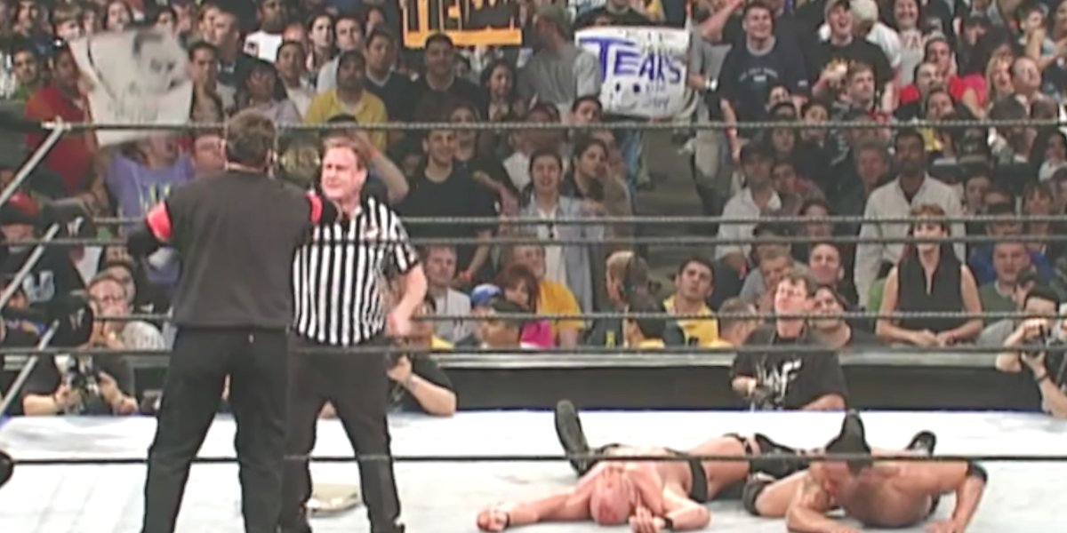 Mr. McMahon, Earl Hebner, Stone Cold Steve Austin, and The Rock at WrestleMania 17