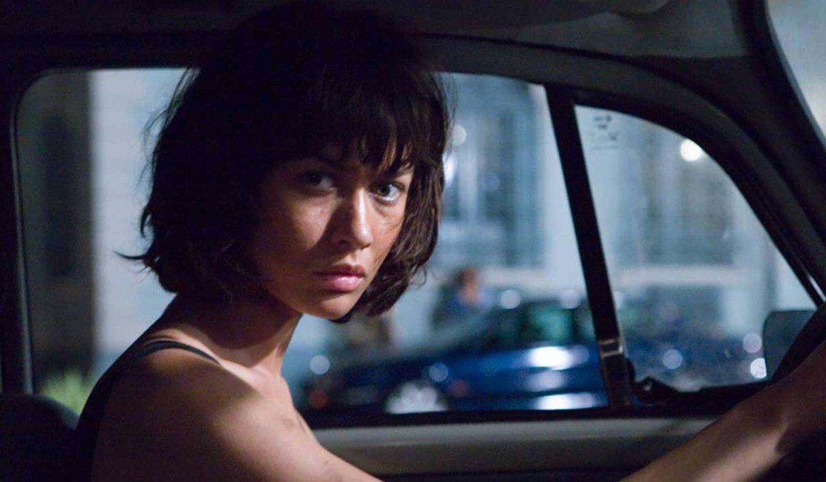Olga Kurylenko behind the wheel of a car in Quantum of Solace