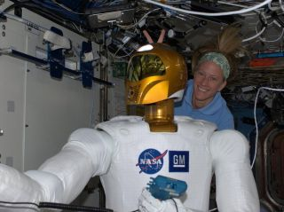 Astronaut Nyberg and Robonaut 2 in a Moment of Levity