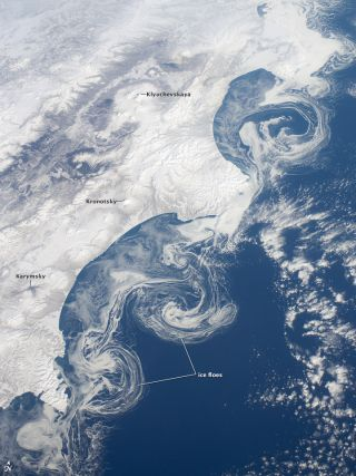 An astronaut aboard the International Space Station snapped this image of swirling ice floes off Russia's Kamchatka Peninsula.