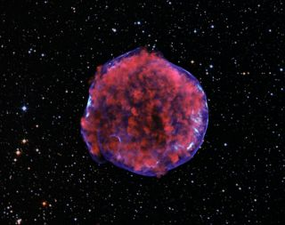 This image comes from a very deep Chandra observation of the Tycho supernova remnant. Low-energy X-rays (red) in the image show expanding debris from the supernova explosion and high energy X-rays (blue) show the blast wave, a shell of extremely energetic