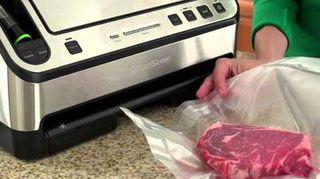 A vacuum food sealer in use