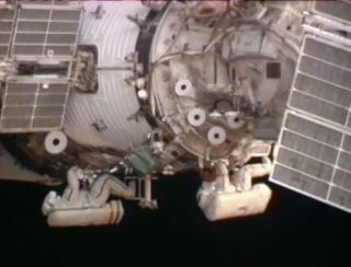 Spacewalkers Prime Space Station For New Docking Port