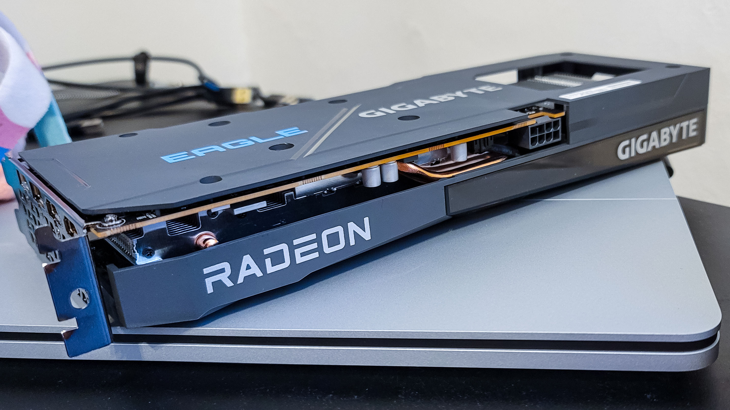 AMD Radeon RX 6600 on a laptop, showing its side design and power connector