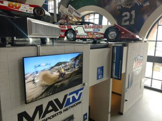 Screens throughout the venue are incorporated into themed exhibits highlighting the history of racing, and Lucas Oil's involvement in the automotive industry.