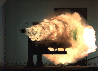 Photo taken from a high-speed video camera during a firing of an electromagnetic rail gun (EMRG) at the Naval Surface Warfare Center in Dahlgren, Virginia, on Jan. 31, 2008.