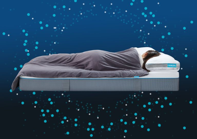 Simba Orbit weighted blanket on a bed