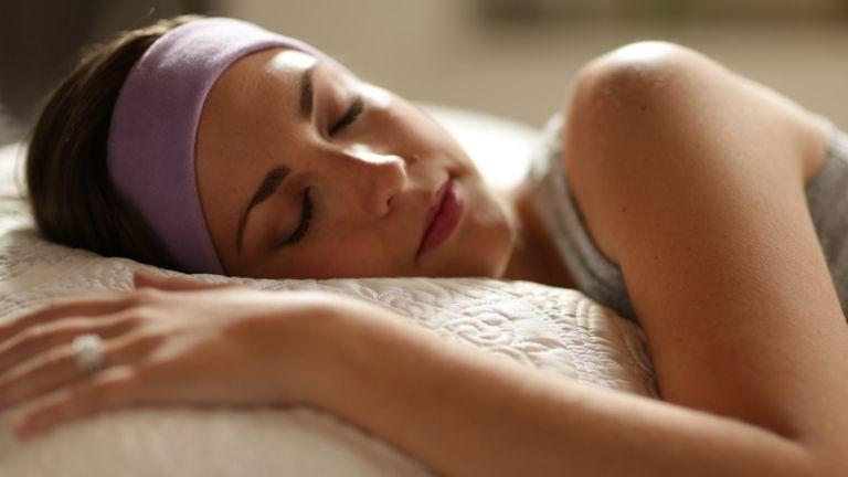 Woman wearing Sleepphones Effortless headphones