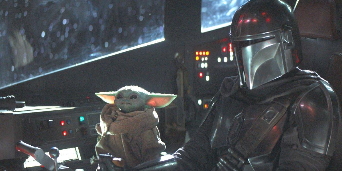 Din Djarin and Baby Yoda traveling through the galaxy