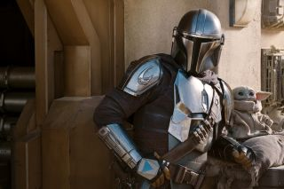 Mando and The Child as seen in Season 2 of The Mandalorian on Disney+.